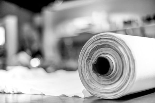 white roll cotton fabric in tailor's shop