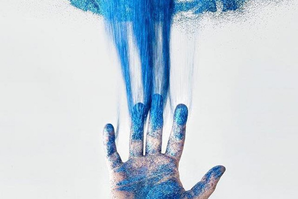 hand covered with blue color