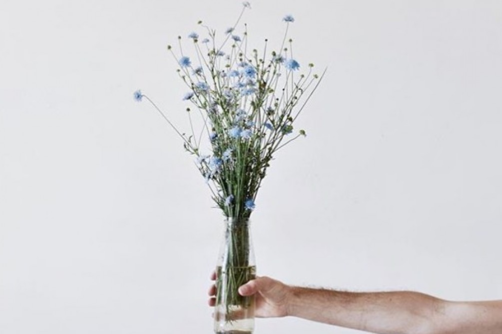 Photo by Michele Grimaz hand keep flowers, sustainable fibers teeshare