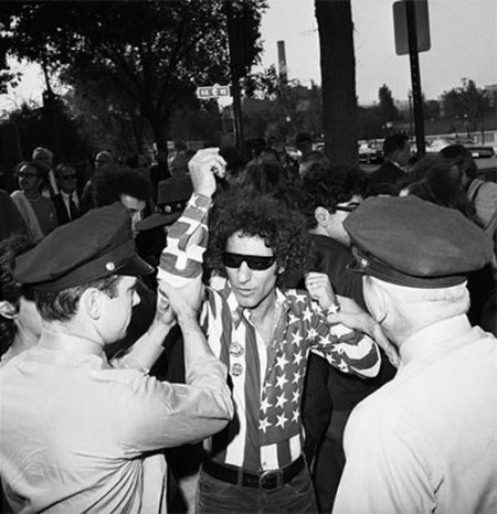 United States Congress, Abbie Hoffman was arrested for wearing a shirt with the American flag on it.